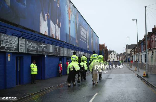 Mounted police patrol outside the stadium prior to the Premier League match between Everton and Hull City at Goodison Park on March 18 2017 in...