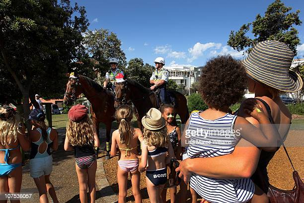 Mounted police secure an area for guests of the Oprah Winfrey show at Bondi Beach on December 12 2010 in Sydney Australia Oprah Winfrey is in...