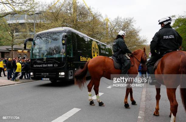 Mounted police stand next to the bus with the players of German football club Borussia Dortmund ahead the UEFA Champions League 1st leg quarterfinal...