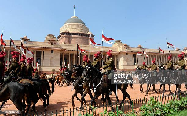 Mounted Presidential Guards practice for the president's arrrival for the forthcoming budget session of Parliament at the Presidential Palace in New...