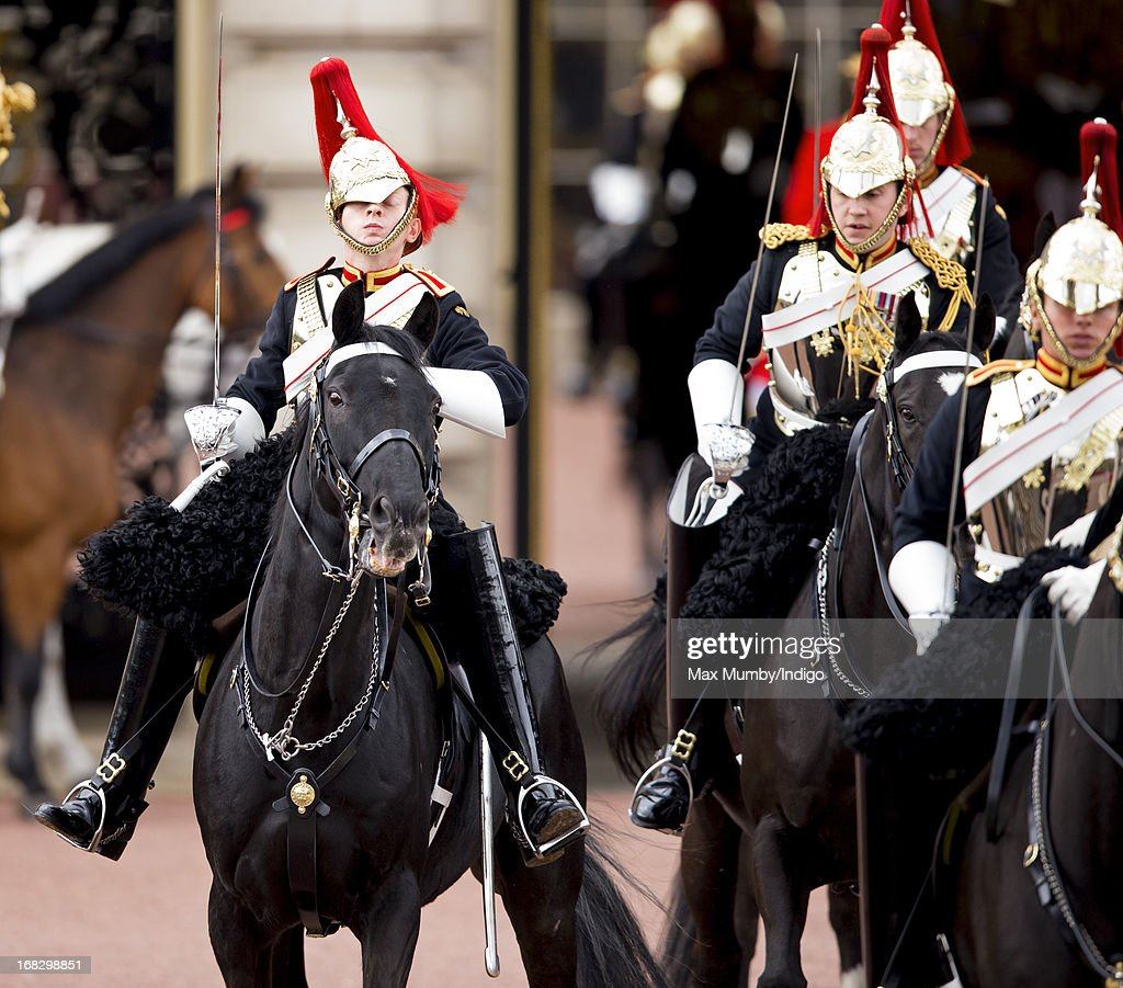 A mounted soldier from the Household Cavalry struggles to control his horse as it spooks whilst leaving Buckingham Palace to escort Queen Elizabeth II to the State Opening of Parliament on May 8, 2013 in London, England. Queen Elizabeth II unveiled the coalition government's legislative programme in a speech delivered to Members of Parliament and Peers in The House of Lords. Proposed legislation is expected to be introduced on toughening immigration regulations, capping social care costs in England and setting a single state pension rate of 144 GBP per week.