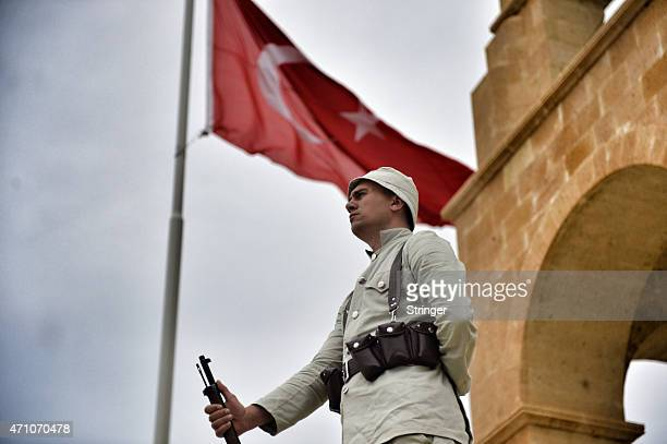 Mounted Turkish gendarmes dressed as World War I Ottoman Turkish soldiers stand guard at the Turkish 57th Regiment Memorial to mark the 100th...