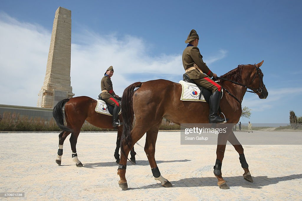 Mounted Turkish gendarmes ride horses past the Helles Memorial which commemorates Commonwealth soldiers killed in the Gallipoli campaign prior to one...