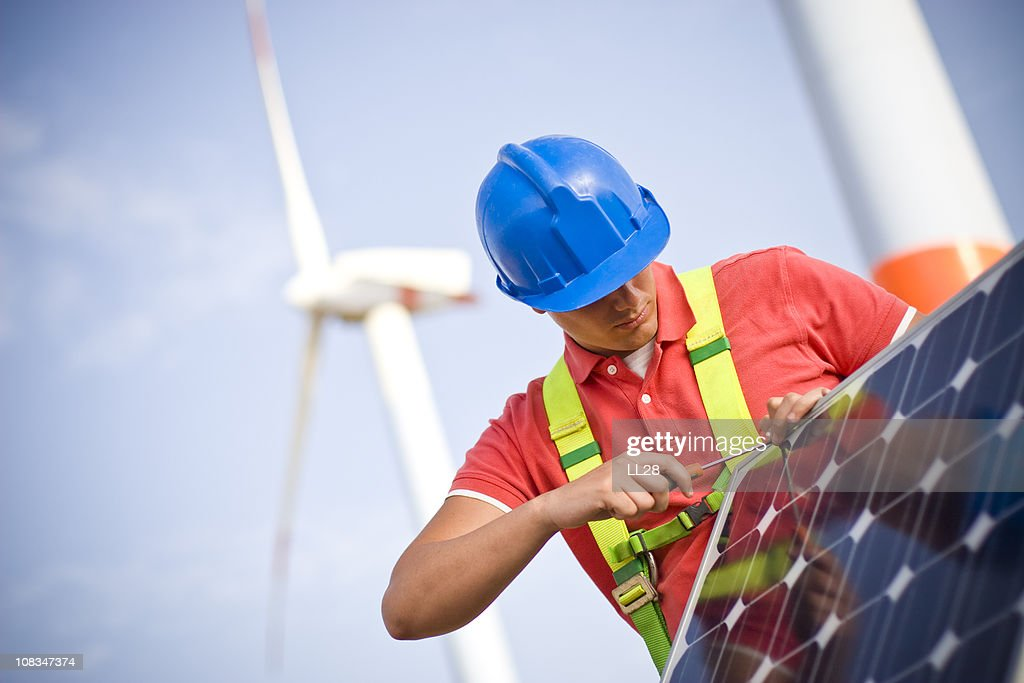 Mounting a solar panel frame : Stock Photo