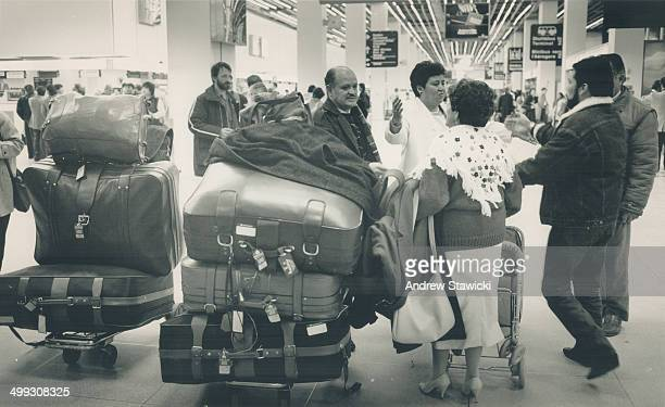 Mounting Confusion Passengers mill around the antiquated and congested Terminal 1 building at Pearson airport struggling with mounds of luggage One...