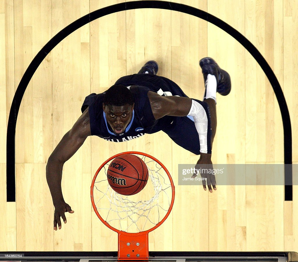 Mouphtaou Yarou #13 of the Villanova Wildcats watches the ball go through the hoop during the second round of the NCAA Basketball Tournament against the North Carolina Tar Heels at the Sprint Center on March 22, 2013 in Kansas City, Missouri.