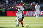 Moura LUCAS of Paris SaintGermain and Younousse Sankhare of Guingamp during the French League 1 match between EA Guingamp and Paris SaintGermain on...