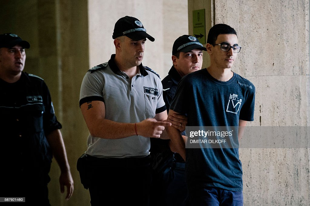 Mourad Hamyd guarded by police officers arrives at court in Sofia on August 10 2016 A Bulgarian court approved the extradition to France of the...