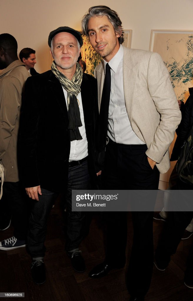 Mourad Mazouz and George Lamb attend a private view of 'Jose Parla Broken Language' at Haunch of Venison on February 7 2013 in London England