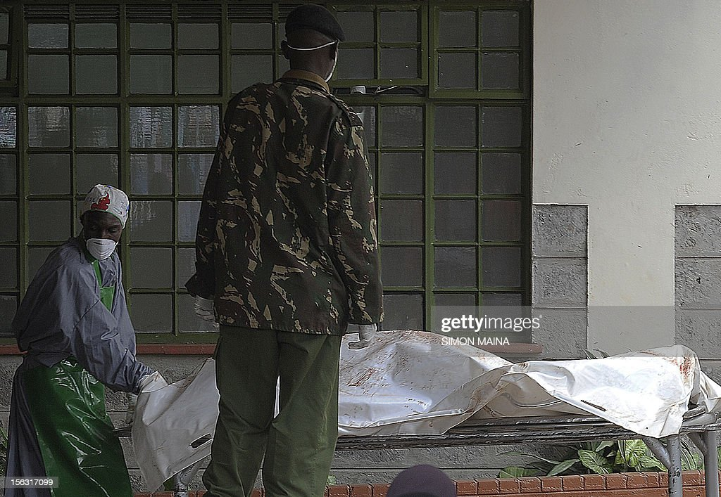 Mourge attendants wheel the body of a policeman at the Chiromo Mortuary in Nairobi on November 13, 2012 after 42 policemen were killed on November 10 by gunmen in the country's deadliest ambush in Baragoi, a remote district in Kenya's arid north. The death toll, of officers hunting cattle thieves, over the weekend has risen to 42 after more bodies were found, police said.