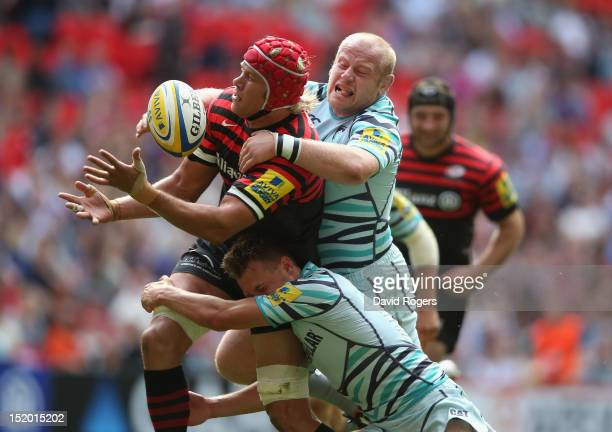 Mouritz Botha of Saracens is tackled by Dan Cole and Sam Harrison during the Aviva Premiership match between Saracens and Leicester Tigers at Wembley...