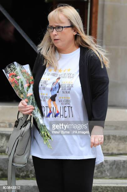 A mourner arrives at the funeral service of Martyn Hett who was killed in the Manchester Arena bombing at Stockport Town Hall Plaza