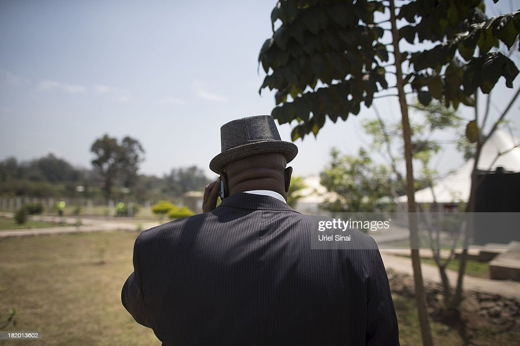A mourner attends a funeral service for Kenyan President Uhuru Kenyatta's nephew Mbugua Mwangi and his fiancee Rosemary Wahito who were killed at the the Westgate Mall terrorist attack, on September 27, 2013 in Nairobi, Kenya. The country is observing three days of national mourning as security forces begin the task of clearing and securing the Westgate shopping mall following a four-day siege by militants.