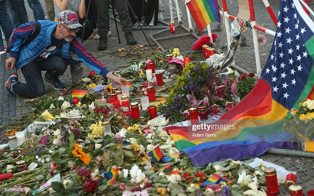 A mourner attends a vigil for victims of a shooting at a gay nightclub in Orlando, Florida nearly a week earlier, in front of the United States embassy on June 18, 2016 in Berlin, Germany. Fifty people were killed and at least as many injured during a Latin music event at the Pulse club in the worst terror attack in the U.S. since 9/11. The American-born gunman had pledged allegiance to ISIS, though officials have yet to find conclusive evidence of his having any direct connection with foreign extremists. The incident has added fuel to the ongoing debate about gun control in the country.