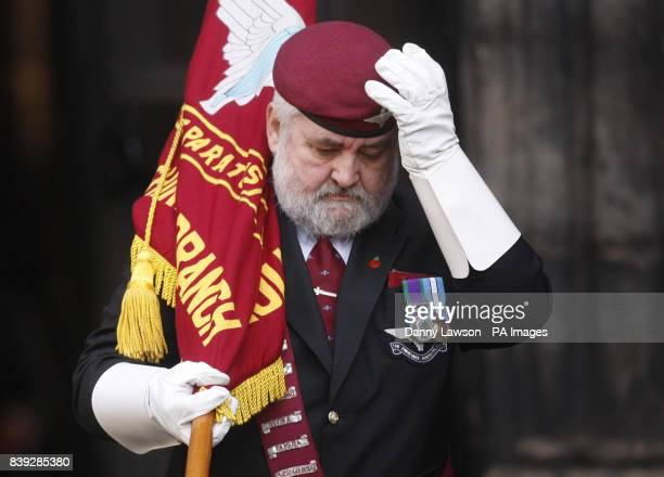 A mourner attends the funeral of Lance Corporal Tommy Brown who was killed by a bomb in Afghanistan three days before Christmas at Glasgow Cathedral