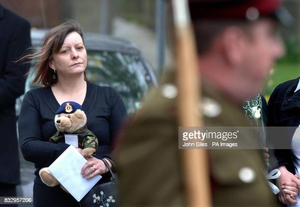 A mourner carrying a teddy bear dressed as an Army medic at the Military Funeral of Corporal Kris O'Neill which took place at St Peters Church...
