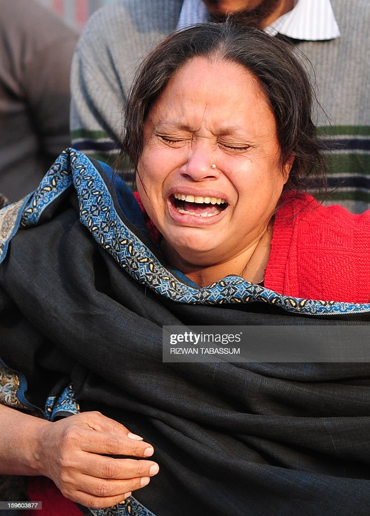 A mourner grieves following the attack on a lawmaker and his guards in Karachi on January 17, 2013. A Pakistani lawmaker from a coalition partner in the government was shot dead with three of his guards in a drive-by shooting in Karachi on Thursday, police said. AFP PHOTO/Rizwan TABASSUM