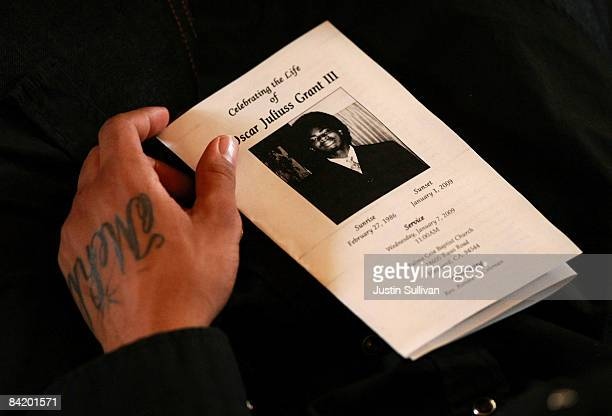 A mourner holds holds a program during funeral services for twenty two yearold Oscar Grant III at Palma Ceia Baptist Church January 7 2009 in Hayward...