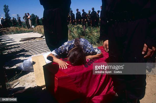 A mourner in Rogova Kosovo grieves over coffin during the funeral of Kosovo Liberation Army soldier who was killed during the Yugoslavian Civil War...