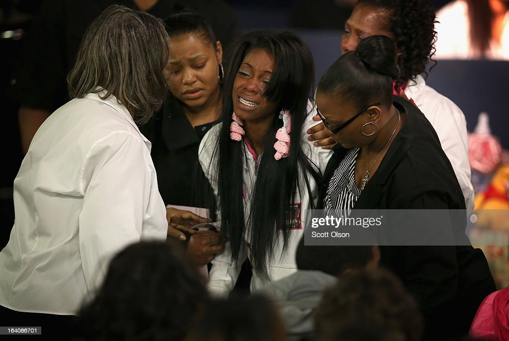 A mourner is overcome with grief after viewing the remains of six-month-old Jonylah Watkins prior to her funeral service at New Beginnings Church on March 19, 2013 in Chicago, Illinois. Watkins was shot, along with her father, while sitting on her father's lap in the family's minivan March 11. Jonylah died the following day. Her father is recovering from his wounds.
