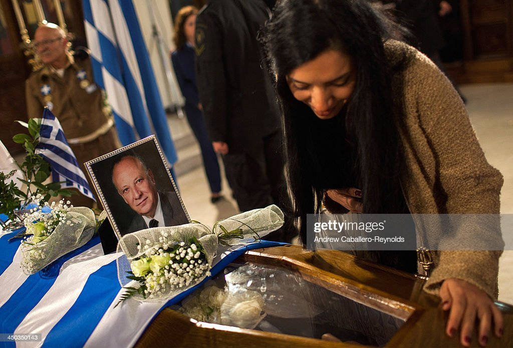 A mourner looks at the body of Former Cypriot President Glafcos Clerides as he lies in state at a church on November 18, 2013 in Nicosia, Cyprus. The Former President, who oversaw his country's entry into the EU in 2004, died at the age of 94 in a Nicosia hospital Friday evening.