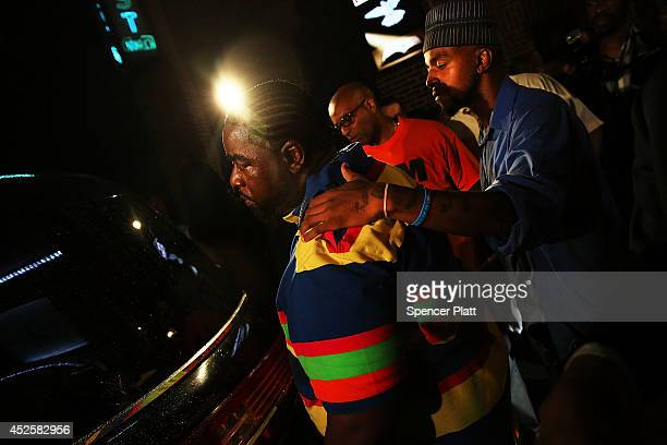 A mourner looks into the hearse carrying Eric Garner outside the Bethel Baptist Church on July 23 2014 in New York City New York Mayor Bill de Blasio...