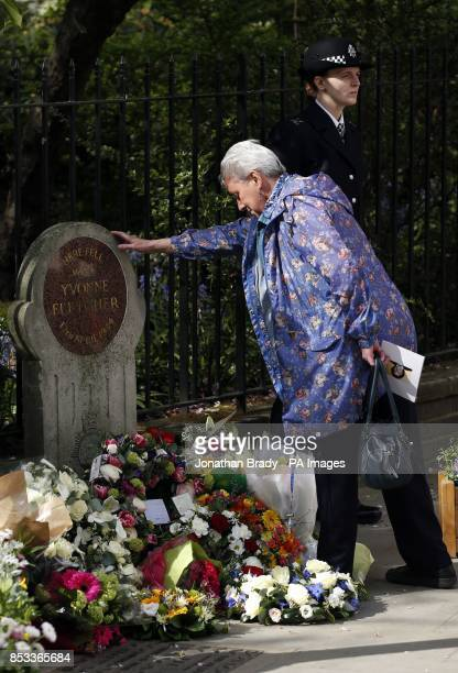 A mourner pays tribute during a memorial service held in St James Square London to mark the thirtieth anniversary of the death of WPC Yvonne Fletcher