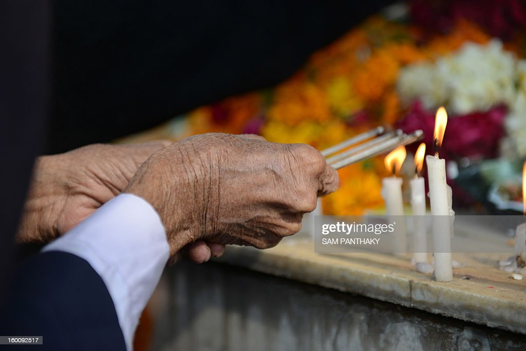 A mourner performs rituals at a memorial outside the Swaminarayan Vidhyalaya on the twelfth anniversary of the Gujarat earthquake in Ahmedabad on January 26, 2013t. Some 32 students of this school died in the quake that killed over 19,000 people. AFP PHOTO / Sam PANTHAKY