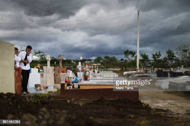 A mourner stands after the burial ceremony of Sonia Irizarry originally from Puerto Rico who passed away on September 23 in Florida on October 14...