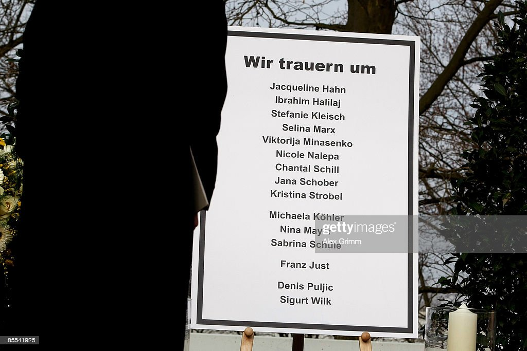A mourner stands in front of a sign with the names of the victims outside Albertville high school on March 21 2009 in Winnenden near Stuttgart...