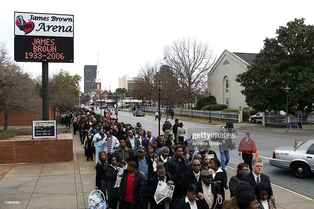 Mourners and fans wait in line to enter the James Brown Arena to view the body of music legend James Brown on December 30 2006 in Augusta Georgia