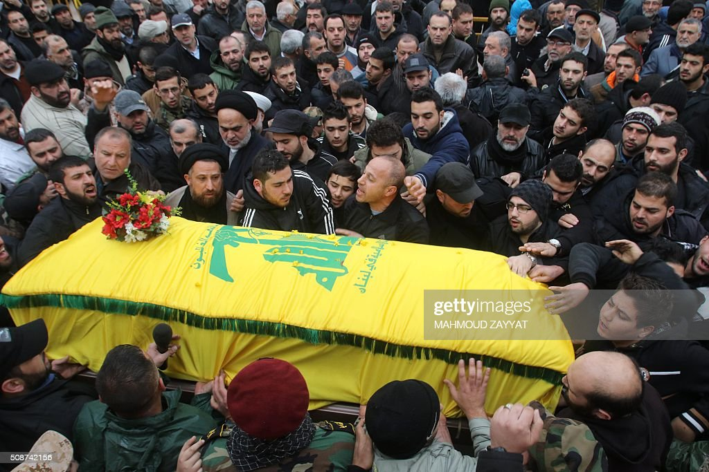 Mourners and members of Lebanon's militant Shiite Muslim movement Hezbollah carry the coffin of Ali Ahmed Sabra, a fellow militant who was killed in combat alongside Syrian government forces in Aleppo, during his funeral on February 6, 2016, in the Lebanese village of Jibshit, about 50 kilometres south of the capital Beirut. / AFP / MAHMOUD ZAYYAT