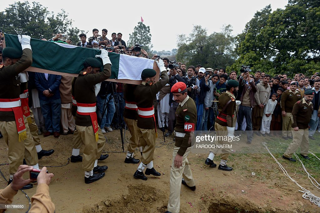 Mourners and military personnel are pictured during the funeral of a Pakistani soldier who was shot dead along the Line of Control (LoC), at a village in Bainso, about 45 kms from the capital Islamabad, on February 16, 2013. Indian troops shot dead a Pakistani soldier along the de facto border in the disputed Kashmir region in the first deadly exchange since a truce was agreed a month ago, officials said Friday. AFP PHOTO/Farooq NAEEM