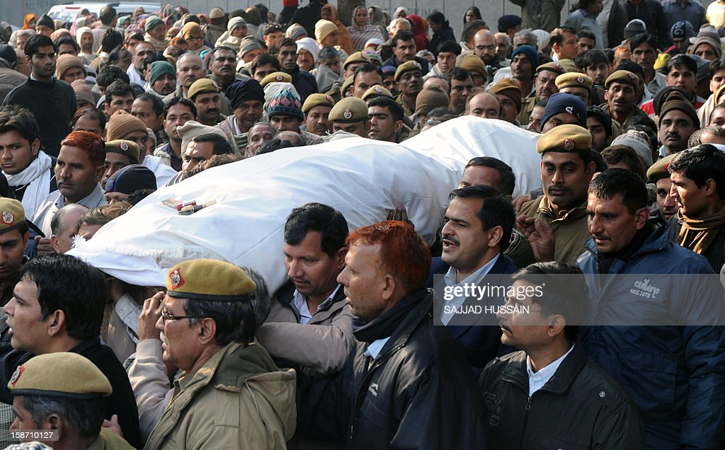 Mourners and relatives of fallen Indian policeman Subash Tomar carry his mortal remains during his funeral in New Delhi on December 25, 2012. Tomar, a 47-year-old constable Indian policeman who was injured in clashes during a protest over a gang-rape in New Delhi has died. Tomar, a 47-year-old constable deployed at the India Gate monument on December 23 to control the protests, was beaten up by a mob and rushed to hospital by the police.