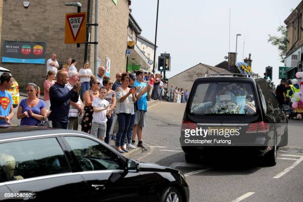 Mourners applaud as the coffin of Manchester attack victim Olivia CampbellHardy leaves The Parish Church of St Anne in Tottington after her funeral...