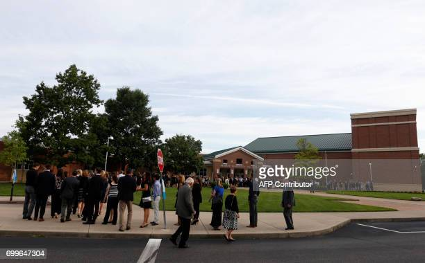 Mourners are seen entering Wyoming High School in Wyoming Ohio on June 22 to attend the funeral for Otto Warmbier Warmbier an American university...