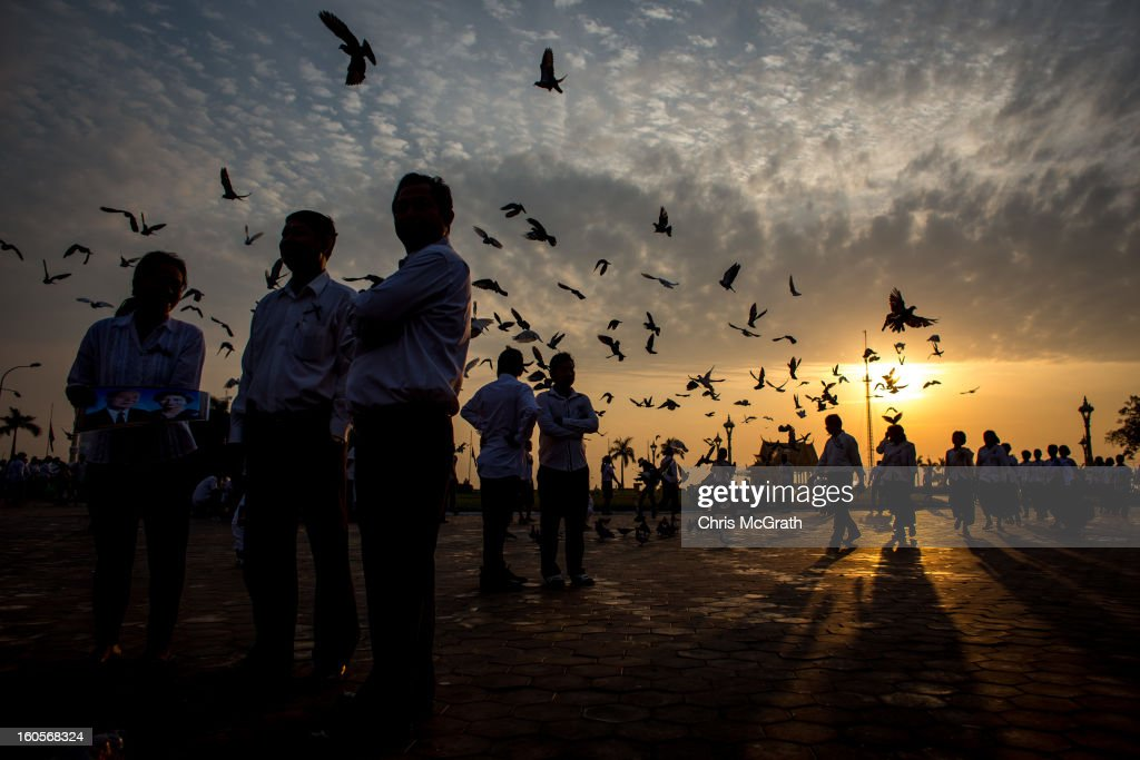 Mourners arrive at sunrise and wait outside the Royal Palace before being allowed to enter the cremation site to pay their final respects to former King Norodom Sihanouk on February 3, 2013 in Phnom Penh, Cambodia. The former kings coffin was transported to the cremation site yesterday after being paraded through the capital in a lavish funeral procession. The cremation will take place on Monday the 4th of February, the funeral pyre will be lit by his wife and son King Norodom Sihamoni.