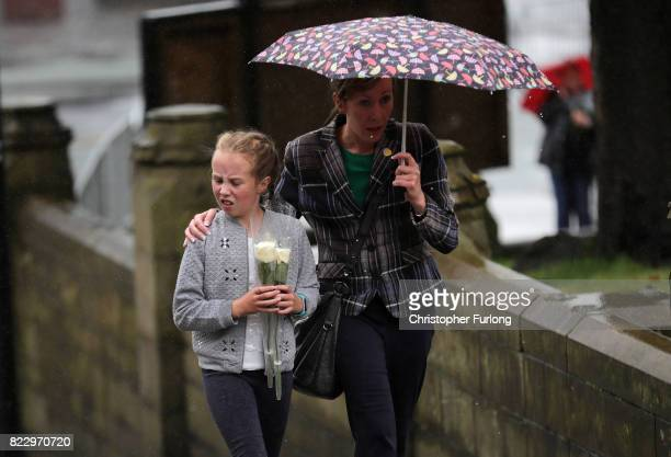 Mourners arrive at the funeral of Manchester Attack victim Saffie Roussos as it rains at Manchester Cathedral on July 26 2017 in Manchester England...