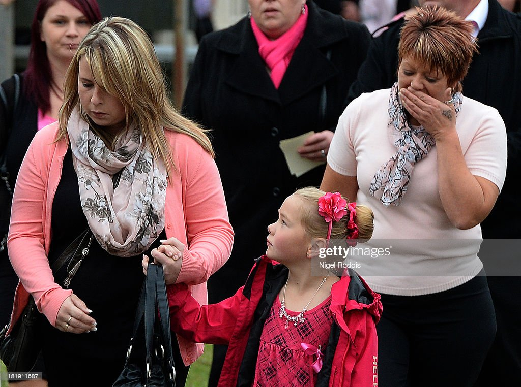 Mourners arrive for the funeral service of murdered schoolgirl April Jones at St Peter's Church on September 26, 2013 in Machynlleth, Wales. Local man Mark Bridger, aged 47, was found guilty of abducting and murdering five-year-old April who went missing in Machynleth on October 1, 2012.