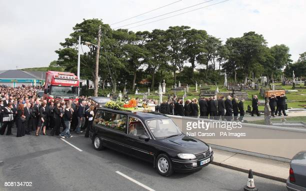 Mourners at the funeral of Paul Doherty follow his coffin to St Mary's Church in Clonmany Co Donegal Mr Doherty was one of eight men who died in...