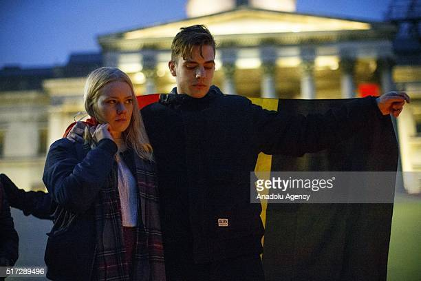 Mourners attend a candle light vigil to pay tribute to Brussels terrorist attacks victims in Trafalgar Square London England on March 24 2016
