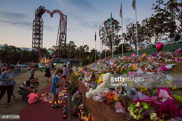 Mourners attend a candlelight vigil outside Dreamworld on October 28 2016 in Gold Coast Australia Four people were killed following an accident on...