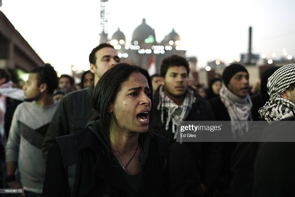 Mourners attend a commemoration ceremony and march for a protester killed during clashes with Egyptian security forces the previous night at the Al...