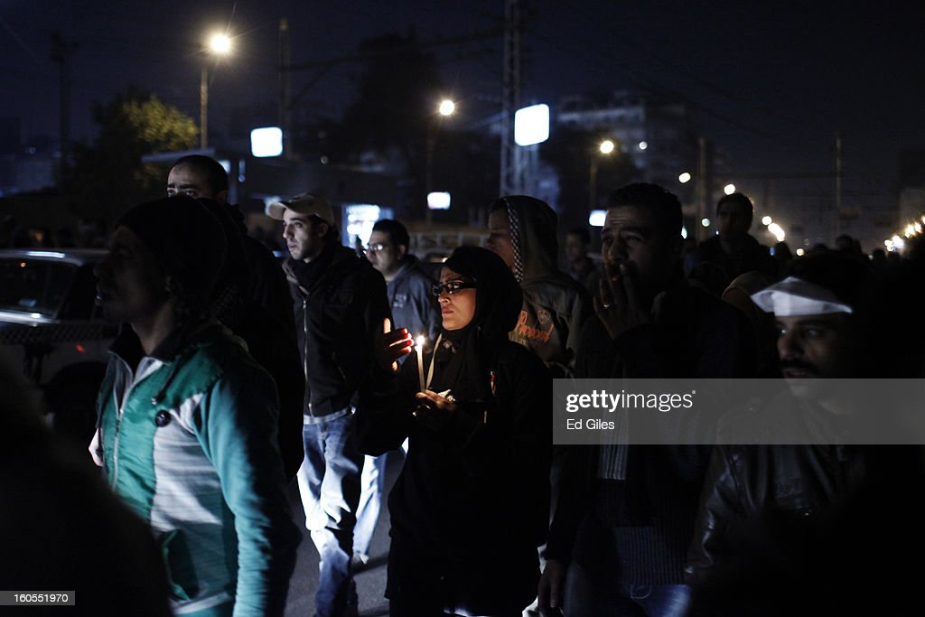 Mourners attend a commemoration march for a protester, killed during clashes with Egyptian security forces the previous night, at the Egyptian Presidential Palace on February 2, 2013 in Cairo, Egypt. 23-year old protester Mohammed Hussein Korani was killed after sustaining gunshot wounds to the neck and chest during fighting with riot police outside Egypt's Presidential Palace in Cairo late on the night of February 1. Protests continued across Egypt nearly one week after the second anniversary of the Egyptian Revolution that overthrew former President Hosni Mubarak on January 25, 2011.(Photo by Ed Giles/Getty Images).