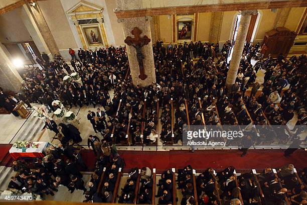 Mourners attend a mass at Saint George Church during the funeral of Lebanese Diva Sabah in Beirut Lebanon on November 30 2014 She was 87 years old