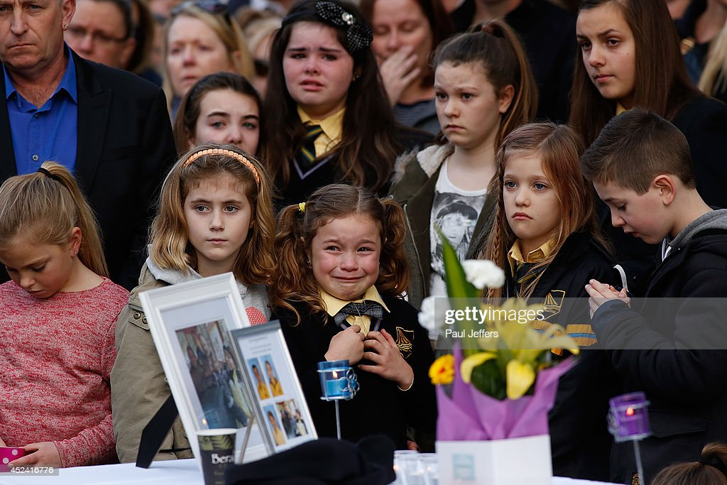 Mourners attend a memorial service held for a family of five killed in the flight MH17 disaster, in the suburb of Eynesbury on July 20, 2014 in Melbourne, Australia. Shaliza Zain Dewa, 45, husband Johannes van den Hende and their children Piers, Marnix and Margaux, aged 15, 12 and 8 were among the 28 Australians on board the Malaysia Airlines flight MH17 that crashed killing all 298 on board. The aircraft was allegedly shot down by a missile and investigations continue over the perpetrators of the attack.