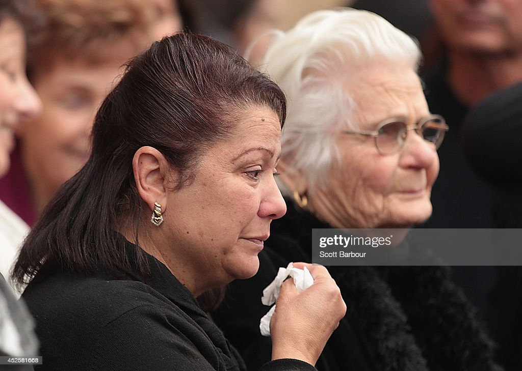 Mourners attend a memorial service held for victims of the MH17 disaster at St Paul's Cathedral on July 24 2014 in Melbourne Australia 18 out of the...