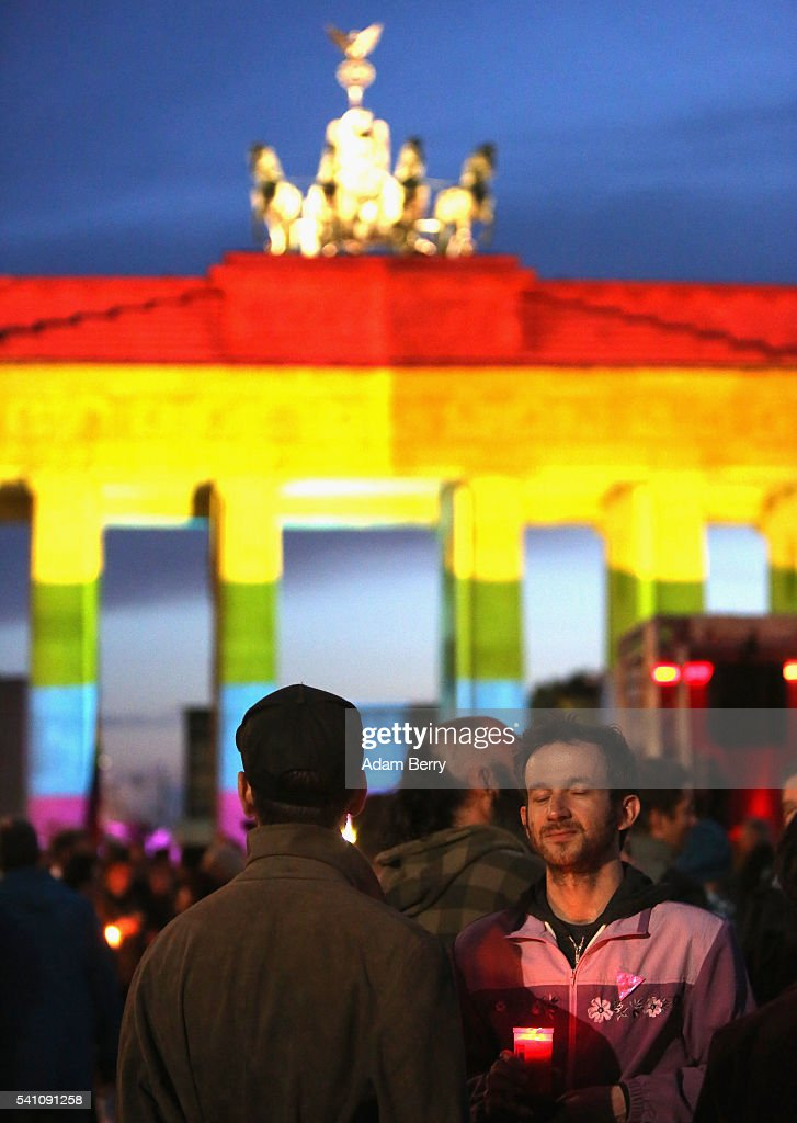 Mourners attend a vigil for victims of a shooting at a gay nightclub in Orlando, Florida nearly a week earlier, in front of the United States embassy on June 18, 2016 in Berlin, Germany. Fifty people were killed and at least as many injured during a Latin music event at the Pulse club in the worst terror attack in the U.S. since 9/11. The American-born gunman had pledged allegiance to ISIS, though officials have yet to find conclusive evidence of his having any direct connection with foreign extremists. The incident has added fuel to the ongoing debate about gun control in the country.