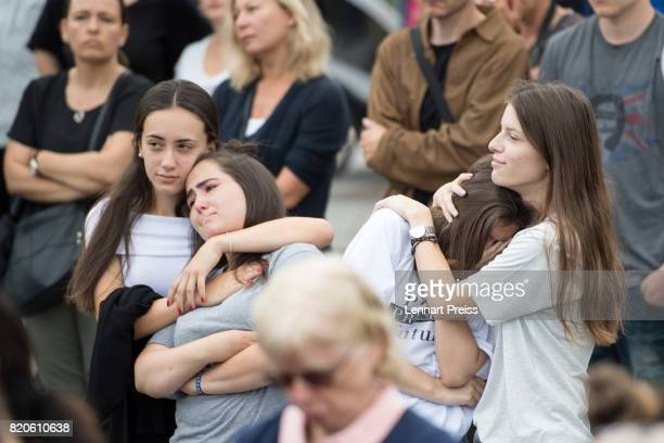 Mourners attend an event to commemorate the first anniversary of the shooting spree that one year ago left ten people dead including the shooter on...