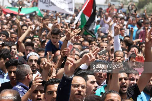 Mourners attend the funeral of 17yearold Mohammed Jawawdeh who was killed on the weekend when he attacked a security guard at the Israeli embassy...